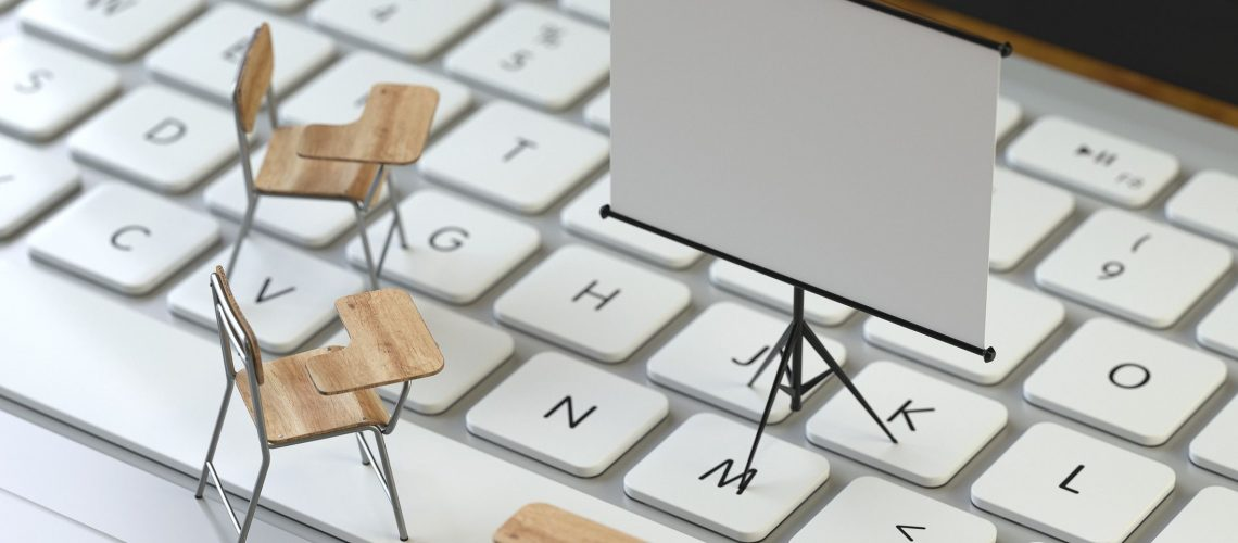 projection screen and chairs on the keyboard of a latop, 3d rendering,conceptual image. training and e-learning concepts.